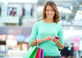 Texting shopper portrait of a smiling sending a text message Stock Image