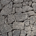 Texture of the black volcanic rock wall Royalty Free Stock Photo