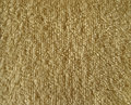 Texture of brown terry cloth fabric close up beige Stock Images