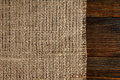 Texture of burlap bordered with old wood background Royalty Free Stock Photography