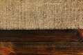 Texture of burlap bordered with old wood background Royalty Free Stock Photos