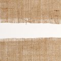 Texture of Burlap hessian square with frayed edges on white background Royalty Free Stock Photo