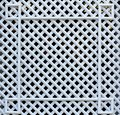 White wooden, square lattice. Texture of cells