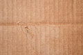 Texture of  clean damaged brown cardboard box. Wavy folded paper Royalty Free Stock Photo