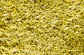 Texture of crumpled alluminium foil close up view gold Stock Photography