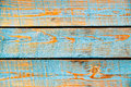 Texture of cyan painted wood three and orange rough wooden planks Royalty Free Stock Photo