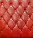 Texture de sofa en cuir rouge de cru Photo libre de droits