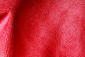 Texture of folds vivid red skin leather background Royalty Free Stock Photo
