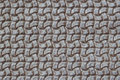 Texture of genuine Braided leather close-up. Fashion trend leather background in grey color, copy space, substrate