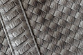 Texture of genuine dark wicker leather close-up and details with stitches of male handbag. For background. Concept of