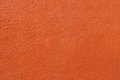 Texture of genuine leather close-up, cowhide, orange. For natural, artisan backgrounds, backdrop, substrate composition Royalty Free Stock Photo
