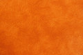 Texture of genuine leather close-up, cowhide, orange. For natural, artisan backgrounds, substrate composition use Royalty Free Stock Photo