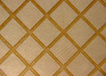 Texture of golden fabric with square pattern