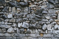 Texture of gray rough granite stone wall Royalty Free Stock Photo