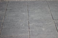 Texture of gray square paving tiles on the entire frame Royalty Free Stock Photo