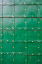 Texture of green old metal door with rivets for background Royalty Free Stock Photo