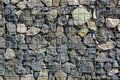 Texture of the iron stack and stones in the wall Royalty Free Stock Photo