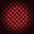 Texture leather quilted a sofa. Red color Royalty Free Stock Photography