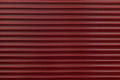 The texture of a metal roller of different colors. The background of the iron blinds. Protective roller shutters for entrance door Royalty Free Stock Photo