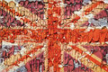 The texture of old paint crackles with the image of the union jack Stock Photo