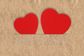 Texture old parchment with two hearts in the slots background Stock Image