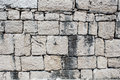 Texture of old wall from squared stone bricks Royalty Free Stock Photo