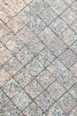 Texture of paving slabs closeup . Grey square pattern.