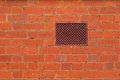 Texture photo of red brick wall with air vent, ventilation Royalty Free Stock Photo