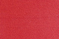 Texture of red fabric, roughly woven, background Royalty Free Stock Photo