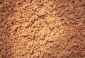 Texture of red soil, close up. Brown cement surface. Rock pattern. Weathered mud, macro. Royalty Free Stock Photo