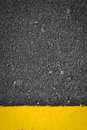 Texture on road and yellow line Royalty Free Stock Images