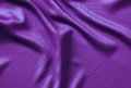 Texture satin. silk background. shiny wavy pattern canvas. color fabric, cloth purple. Royalty Free Stock Photo