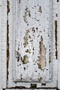 Texture of a shabby old white paint on a wooden door Royalty Free Stock Photo