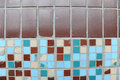Texture of small square tiles. Beige, blue, turquoise and brown
