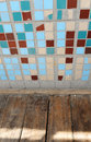 Texture of small square tiles and wooden floor. Beige, blue, turquoise and brown