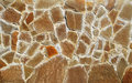 The texture of stone brown varying shapes and sizes sealed with cement Royalty Free Stock Photo