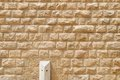 Texture of the wall built of rough yellow stone blocks Royalty Free Stock Photo