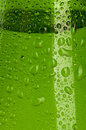 Texture water drops on the bottle green Royalty Free Stock Images