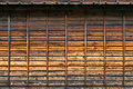 Texture of weathered traditional wooden wall in dark brown color Royalty Free Stock Photo