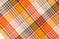 The texture of white checkered, orange, red, black cotton fabric Royalty Free Stock Photo