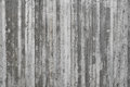 Texture of wooden formwork stamped on a raw concrete wall Royalty Free Stock Photo