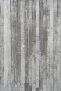 Texture of wooden formwork stamped on a raw concrete wall