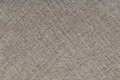 Texture woolen cloth a background is out of grey fabric Stock Images