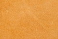 Texture of wrong side genuine leather close-up, cowhide, light orange. For natural, artisan backgrounds, substrate