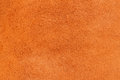 Texture of wrong side genuine leather close-up, cowhide, orange. For natural, artisan backgrounds, substrate composition Royalty Free Stock Photo
