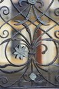 The texture of the wrought-iron grille on the window.Close. Artistic forging Royalty Free Stock Photo