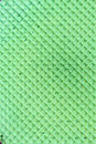 Textured abstract background. Colourfull green waffle. Close up. Flat lay
