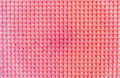 Textured abstract background. Colourfull pink waffle. Close up. Flat lay