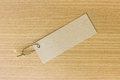 Textured blank tag tied with brown string. Price tag Royalty Free Stock Photo