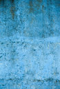 Textured blue wall with stains and spots Royalty Free Stock Photo